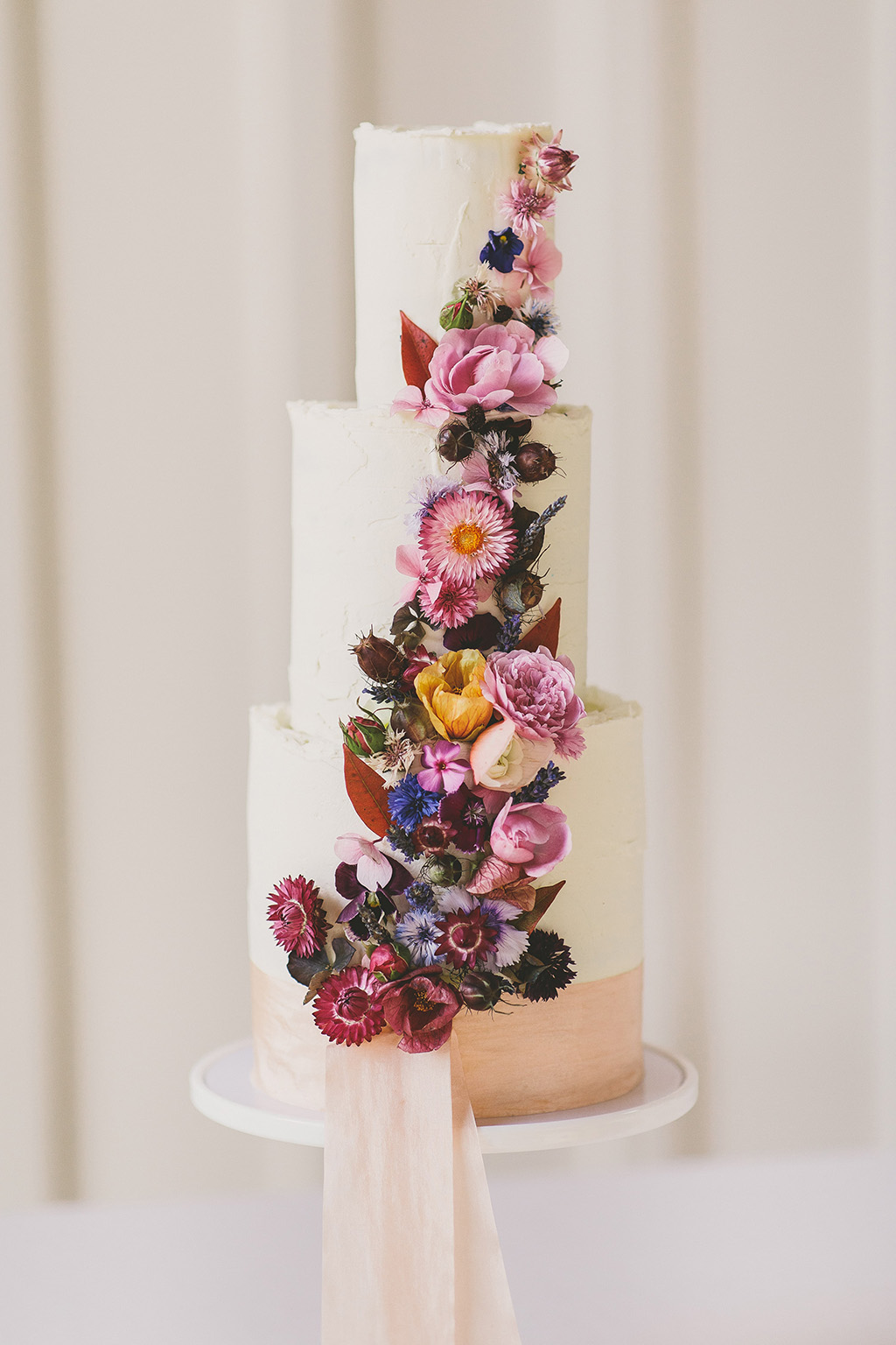 Tiered wedding cake with beautiful dried flower cascade, Scrumptious Bakes by Emma