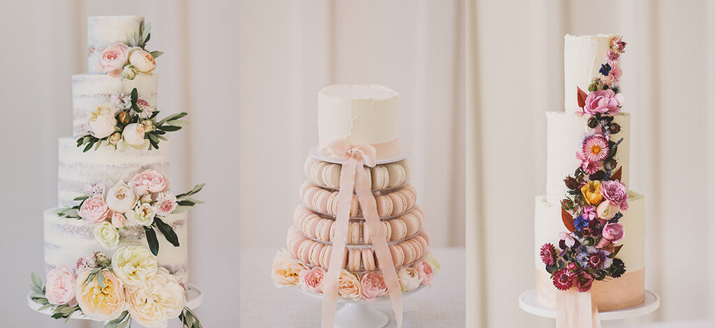 Three tiered wedding cakes, one with pastel flowers, one with macarons and one with dried flowers, by Scrumptious Bakes by Emma