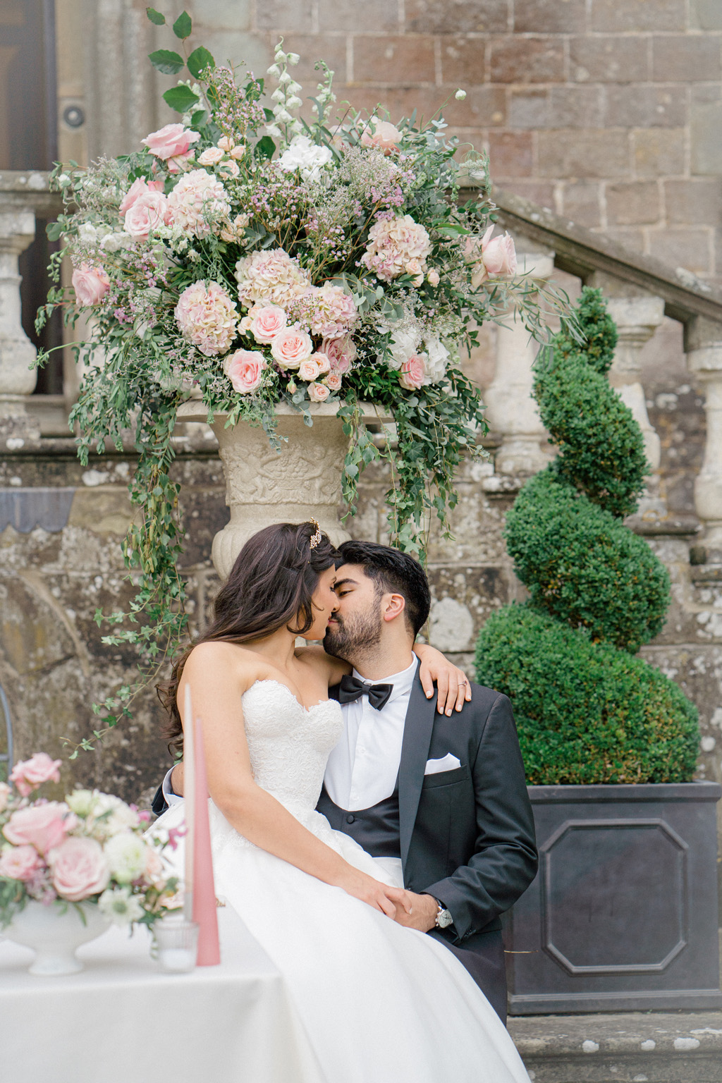 Clearwell Castle bride and groom photoshoot with white and pink floral inspiration