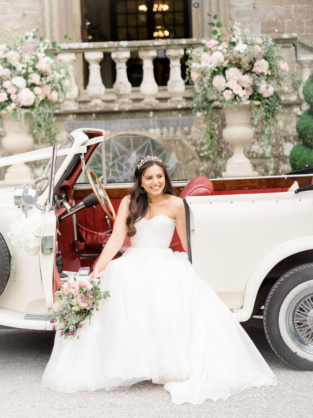 Clearwell Castle wedding blog bride and groom with table styling and extravagant styled florals