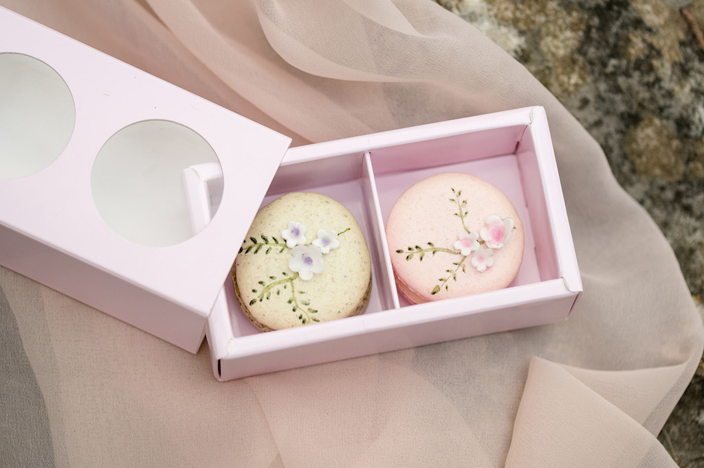 box of 2 wedding macarons with painted floral detail