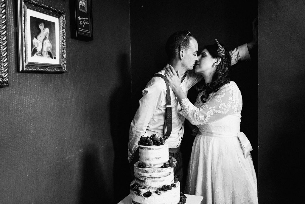 A relaxed and candid wedding in Islington. The bride and groom wear sunglasses, they're laughing with their friends and the images are authentic and unposed. Photographer credit York Place Studios
