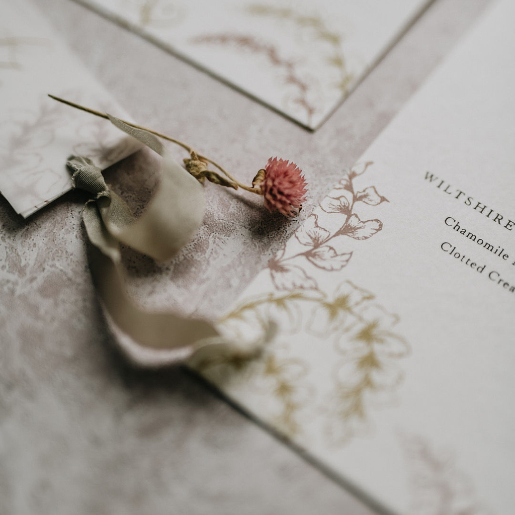 Silk ribbon and botanical illustration detail of an artisan wedding invitation by Inkflower Press