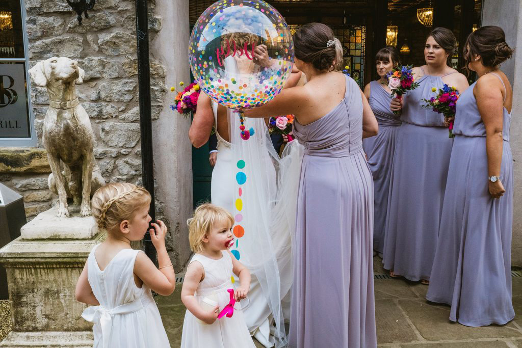 authentic and natural photography from Matt and Kate's Holmes Mill wedding in Clitheroe. There are children playing and none of the images are posed